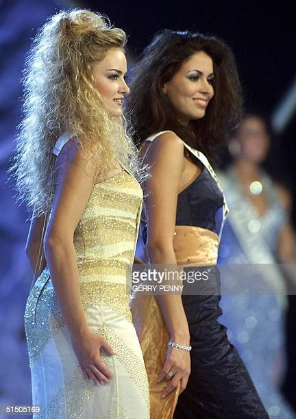 24 year old Raja Moussaoui of Holland and 21 year old Irina Ovtchinnikova of Estonia pose on stage during the Miss World final at the Millenium Dome...