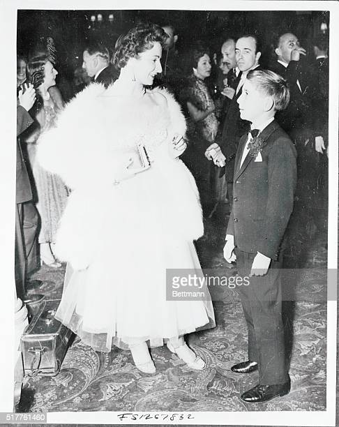 13 year old Renzo Rossellini son of director Roberto Rossellini is shown with Miss Nucci Barbieri his cousin when they attended the Variety Club...