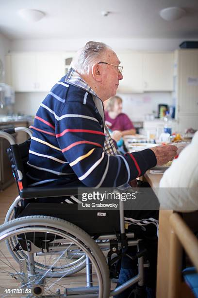 A 90 year old resident sitting in his wheelchair eating lunch at a nursing home pictured on October 16 2013 on the island of Borkum Germany