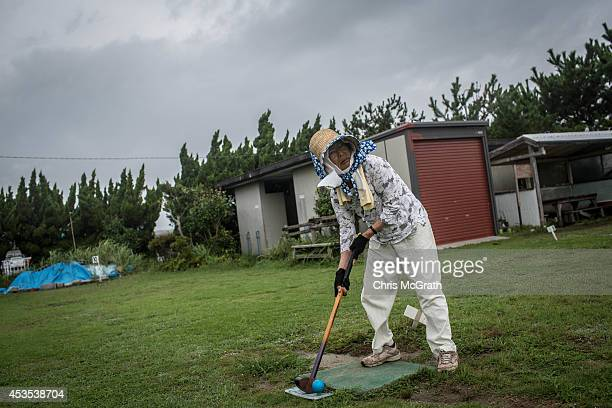 79 year old retiree Sumie Shimomura lines up her shot during a game of ground golf on August 10 2014 in Omaezaki Japan The town of Omaezaki is living...