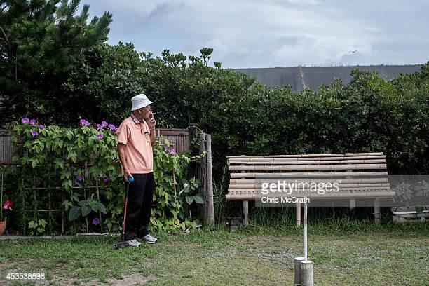 74 year old retiree Toshikatsu Suzuki takes a break while playing a game of ground golf on August 11 2014 in Omaezaki Japan The town of Omaezaki is...