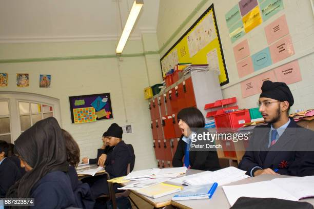 15 year old Robyn Kullar whose family are Sikh yawns in a Religious Education class learning about aspects of Islam Villiers High School is in the...