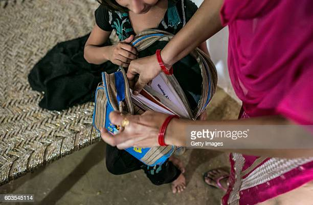 8 year old Sadaf and her aunt take out books for her to study on September 8 2016 in Uttar Pradesh India 3 months ago she was raped by a doctor in...