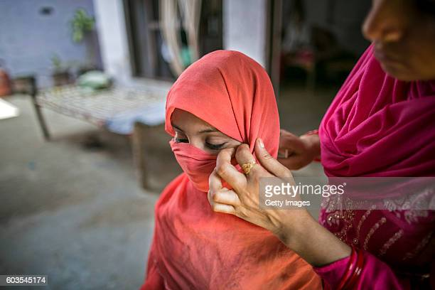 8 year old Sadaf has her scarf adjusted by her aunt before she stands for a photo on September 8 2016 in Uttar Pradesh India 3 months ago she was...