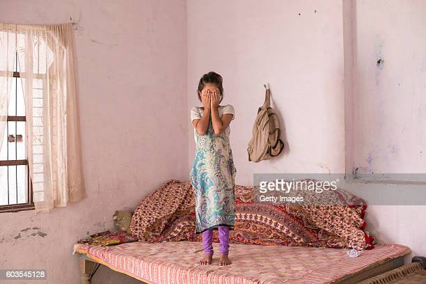 8 year old Sadaf stands for a photo on September 8 2016 in Uttar Pradesh India 3 months ago she was raped by a doctor in her village She was walking...