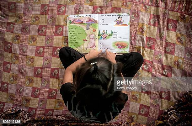 8 year old Sadaf studies in her room on September 8 2016 in Uttar Pradesh India 3 months ago she was raped by a doctor in her village She was walking...