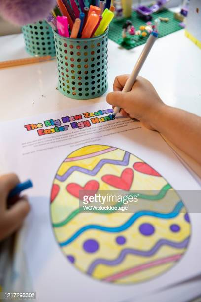 8 year old Sara Thomson colours in an Easter Egg to be displayed as part of the Big New Zealand easter Egg Hunt on April 07 2020 in Auckland New...