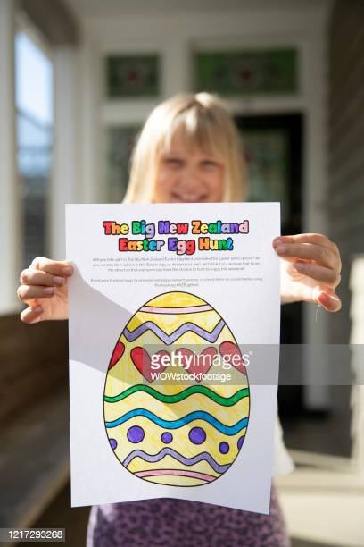 8 year old Sara Thomson shows off the coloured in an Easter Egg that will be displayed as part of the Big New Zealand easter Egg Hunt on April 07...