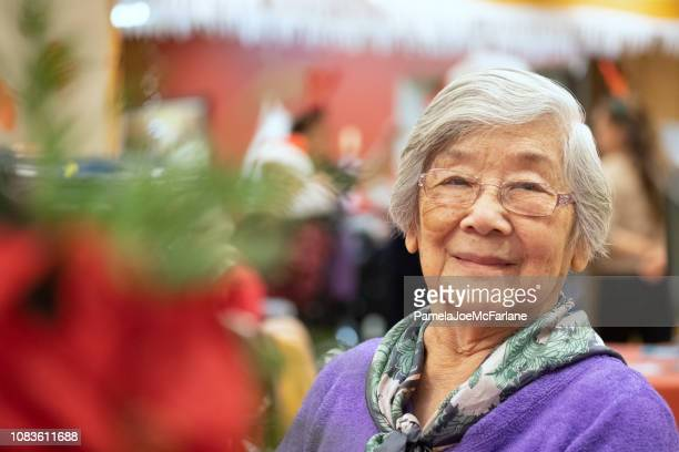 90 year old senior asian woman portrait, at christmas party - 90 plus years stock pictures, royalty-free photos & images