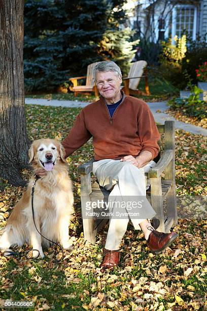 66 year old senior man with golden retriever dog