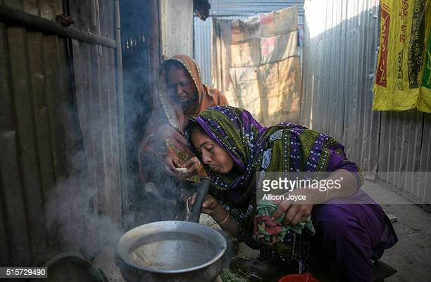 35 year old Shahanara Begum prepares food in her kitchen outside her home March 15 2016 in Dhaka Bangladesh Saharan plans to work as a housekeeper in...