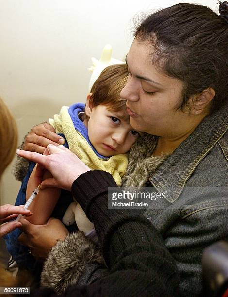 3 year old Sheldon Reid is held by mother Masina as he is one of the first children to be given the vaccinations for meningococcal B at the Mangere...