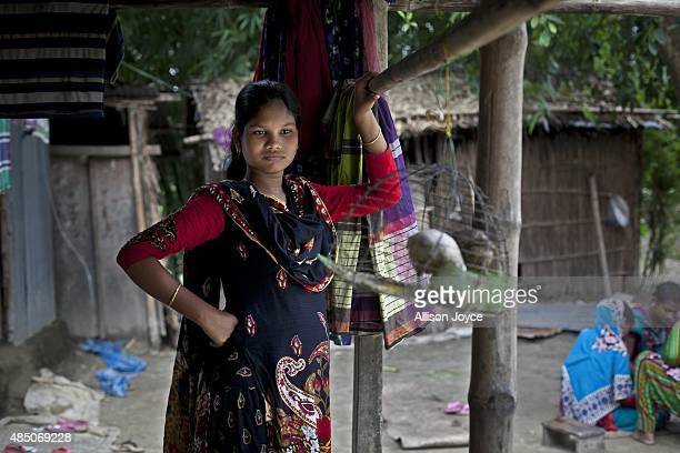 14 year old Shima Akhter stands on the front porch of her home August 19 2015 in Manikganj Bangladesh Last year when she was 13 Shima married an 18...