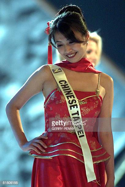 Year old Shu-Ting Hoo of Taiwan poses on stage during the Miss World final at the Millenium Dome in London, 30 November 2000.