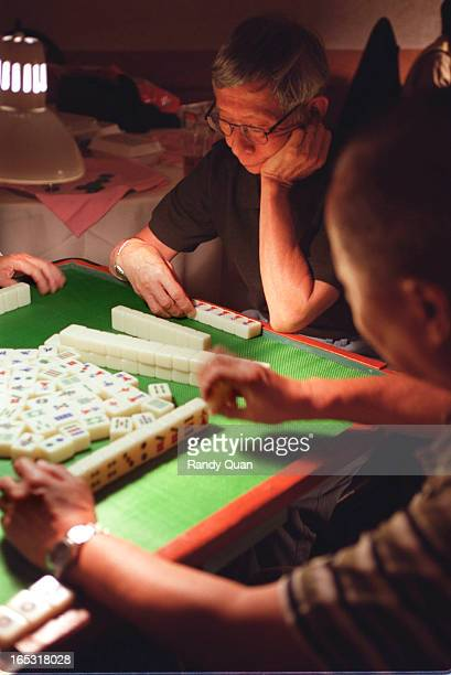 70 year old Simon So ponders his next move during a game of Mahjong Forbidden City Story on group of seniors who spend most of their day in the back...