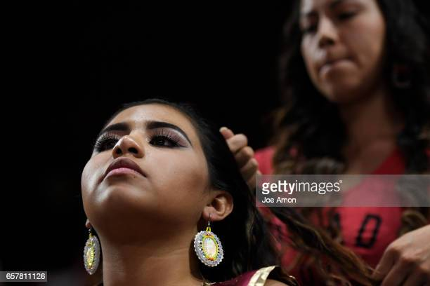 17 year old Sunrose Standing Bear of the Navajo tribe having her hair braided by her aunt Kimberly Standing Bear Light in the Lodge of the Lakota...