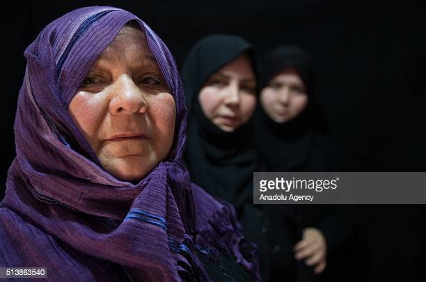 58 year old Syrian refugee woman Varde Haci who lost her 2 daughters and son in laws during a civil war in Syria pose for a photograph with her...