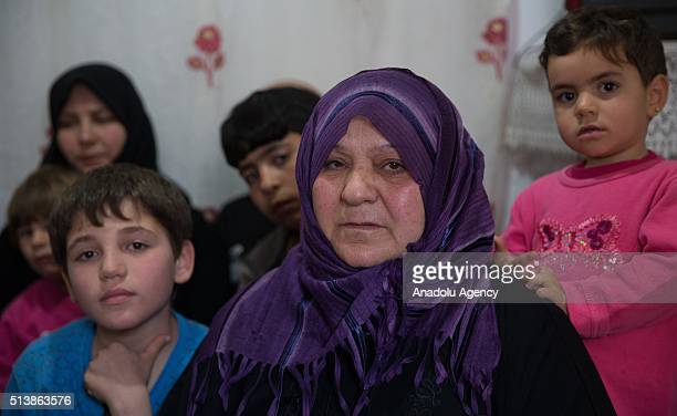 58 year old Syrian refugee woman Varde Haci who lost her 2 daughters and son in laws during a civil war in Syria lives with her 20 grandchildren son...