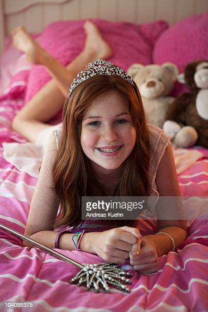 13 year old teenage girl with tiara and wand. - beautiful girl smile braces vertical stock photos and pictures