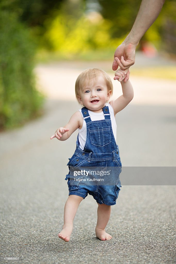1 year old Toddler learning to walk : Stock Photo