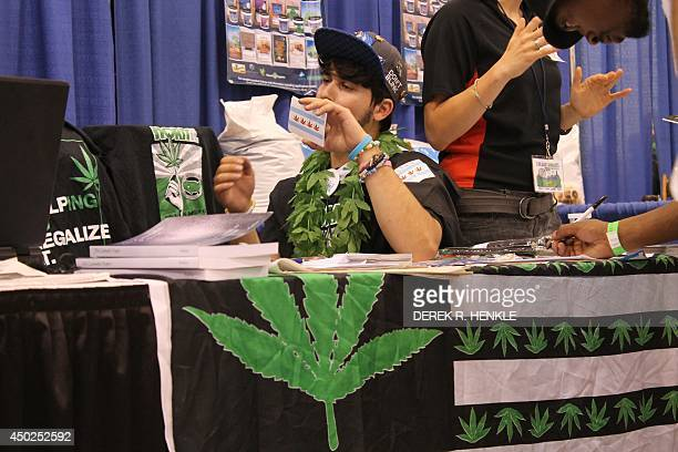 20 year old Tommy Ischerwood of Chicago Illinois displays a remake of the city's official flag altered to include marijuana leaves as he signs up...