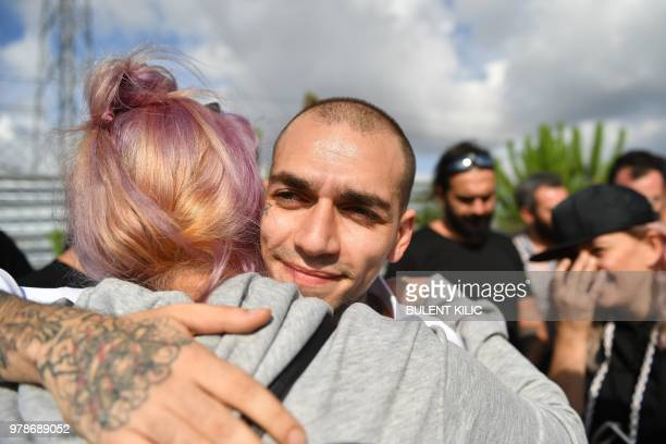 28 year old Turkish rapper 'Ezhel' whose real name is Omar Sercan Ipekcioglu hugs a friend in front of the Anadolu Courthouse after he was released...