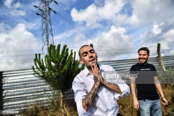 28 year old Turkish rapper 'Ezhel' whose real name is Omar Sercan Ipekcioglu reacts after he was released on June 19 2018 in front Maltepe prison in...