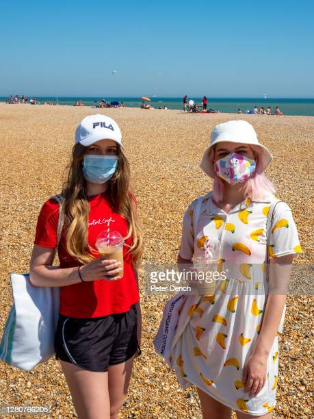Year old twins Antonia and Dounya visit Hastings beach on a hot day during a week lockdown restrictions continued to ease.