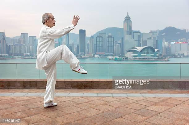 80 year old William Ng practicing Tai Chi