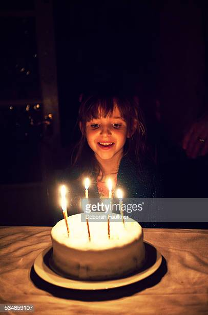 7 year old with birthday cake & candles