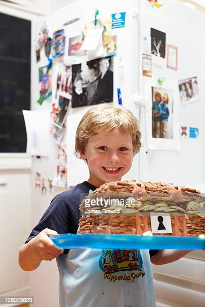 6 year old with birthday cake