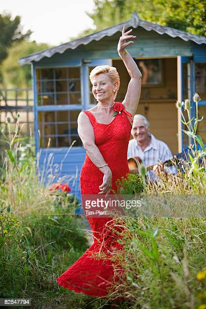 63 year old woman dancing in garden