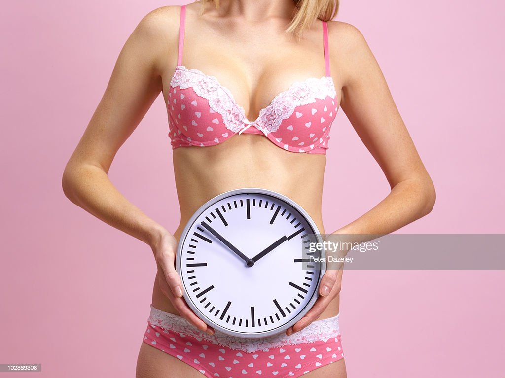 28 year old woman with biological clock ticking : Stock Photo