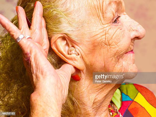 70 year old woman with hearing aid