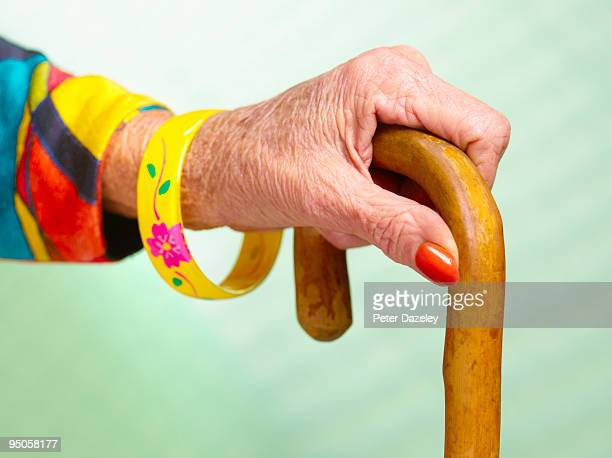 70 year old woman's hand holding walking stick - leaning disability stock pictures, royalty-free photos & images