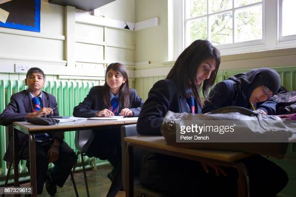 15 year old year 11 pupil Laiba Abbasi in a Maths lesson at Villiers High School She is studying hard in class for her mock GCSE exams Villiers High...