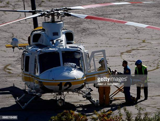 A 49–year old–man trapped in his wrecked car overnight after he plunged 150 feet down a ravine in the Angeles National Forest is transported into a...