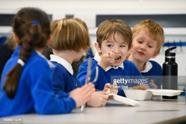 Year two pupils eat their lunch at their desks, as classes return to Gamlingay Village Primary on March 08, 2021 near Bedford, United Kingdom. The...