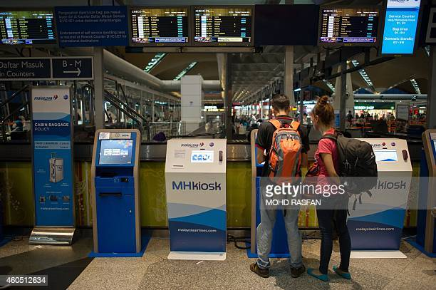 Year2014aviationaccidentsafetyFOCUS BY Dan Martin This photo taken on December 11 shows tourists using a Malaysia Airlines kiosk at Kuala Lumpur...