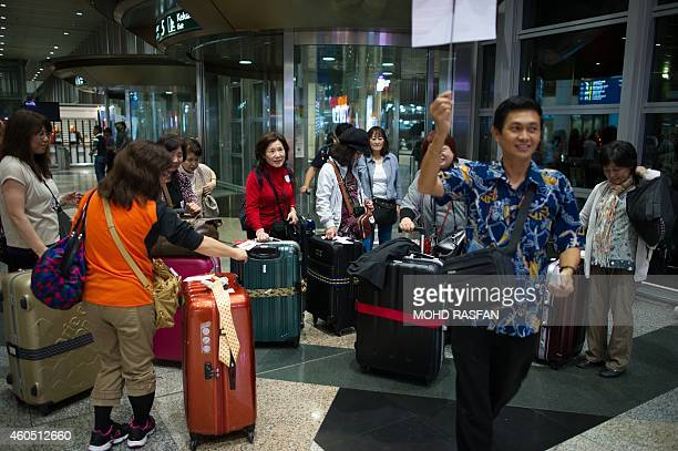 Year2014aviationaccidentsafetyFOCUS BY Dan Martin This photo taken on December 11 shows tourists arriving at Kuala Lumpur International Airport in...