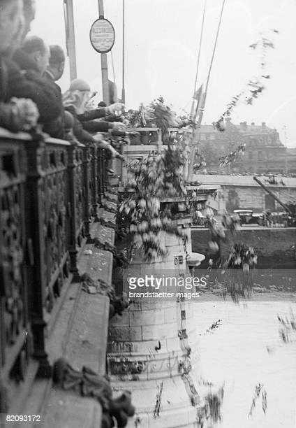 Yearly festival in honour fo Jeanne DArc in Rouen Flowers being thrown into the Seine Photograph France Around 1930 [Jhrliches Fest zu Ehren von...