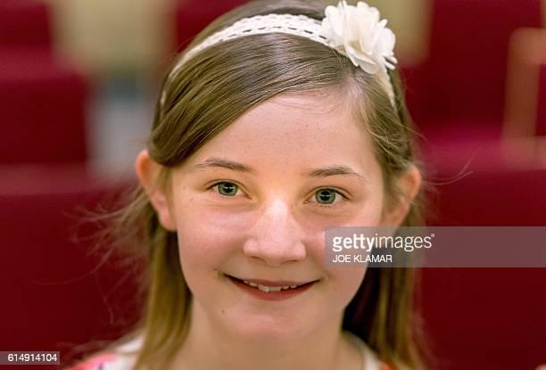 11 yearold Alma Deutscher poses for a photographer in the hallway of The Wiener Musikverein in Vienna on October 6 2016 The British 11yearold's opera...