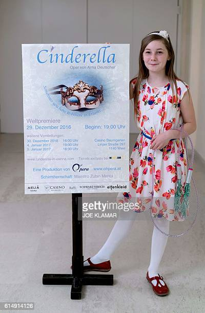 11 yearold Alma Deutscher poses for a picture with a placard of the opera 'Cinderella' in the hallway of The Wiener Musikverein in Vienna on October...