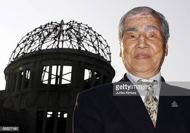 80 yearold atomic bomb survivor Sunao Tsuboi stands in front of the Atomic Dome in the Hiroshima Peace Memorial Park on August 5 2005 in Hiroshima...