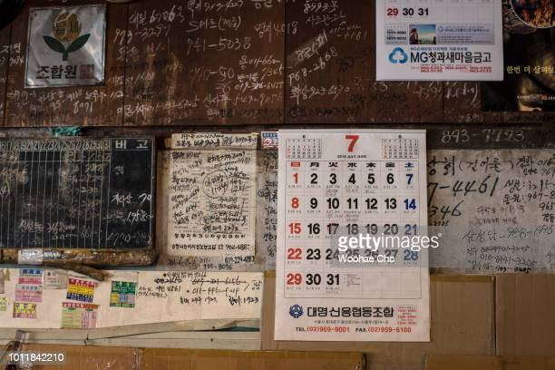 82 yearold Baek Seokhoon looks back the projected map of his home town Bakcheongun in Pyeonganbukdo North Korea in his store in Seoul South Korea on...