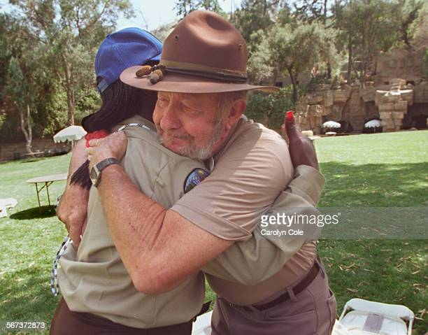 77–year–old Bud Wilbur of San Diego who joined the Civilian Conservation Corps back in l937 gives a hug to Juanita Tolliver age 23 of Long Beach at...