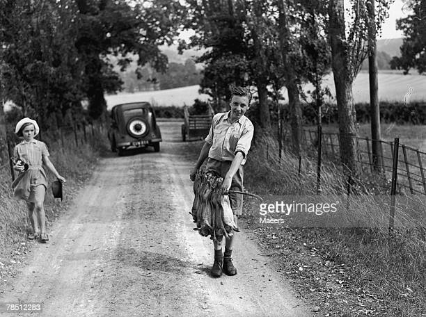 14 yearold evacuee Teddy Neale with a catch of rabbits near Stanton in the Cotswolds 10th August 1944 Teddy his mother and sister are from Shepherds...