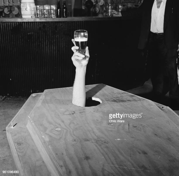 33 yearold Irish builder Mick Meaney holding up a glass of beer from inside his speciallymade coffin laid out upstairs at the Admiral Nelson pub in...