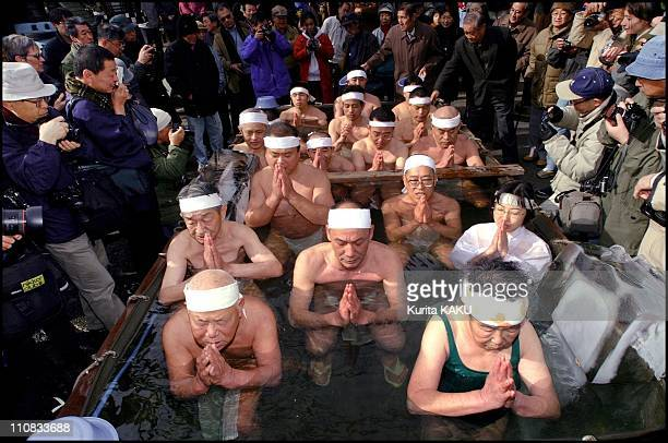 YearOld Japanese Man Bathes In Ice To Pray For A Happy New Year 2001 In Tokyo Japan On January 14 2001 Japanese men bathing in ice