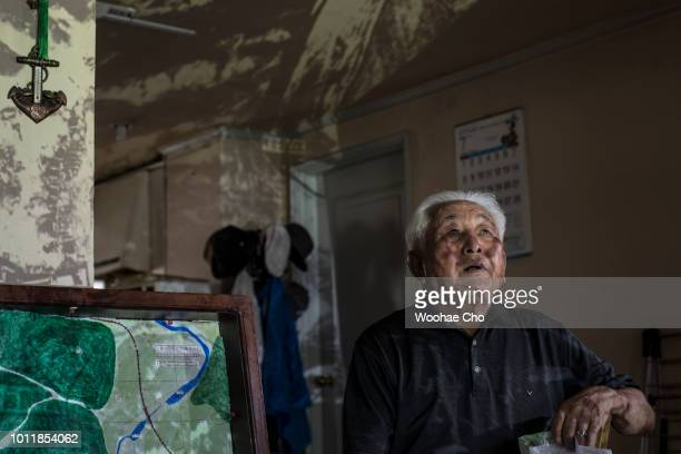 90 yearold Kim Guhyeon from Guseonggun Pyeonganbukdo in North Korea sits in front of projected map of his hometown in his appartment in Uijeongbu...